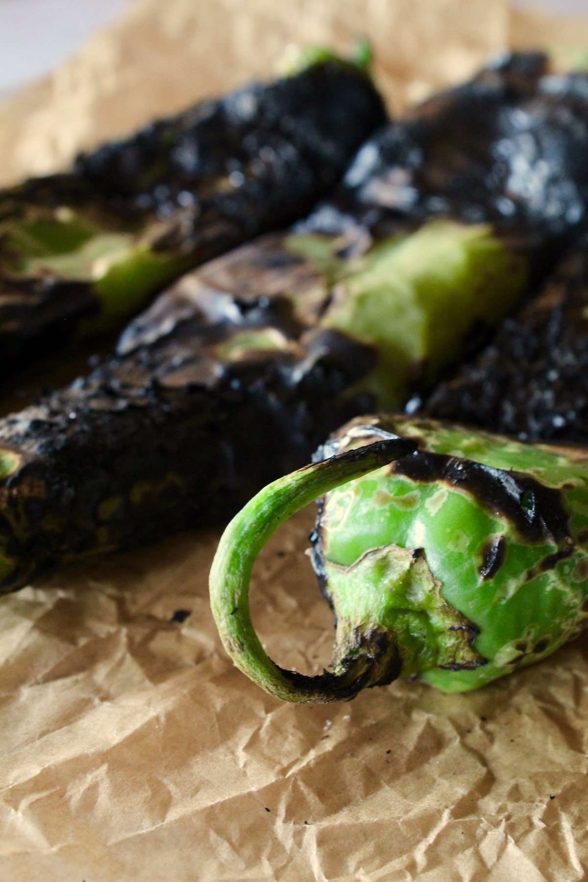 three roasted hatch peppers