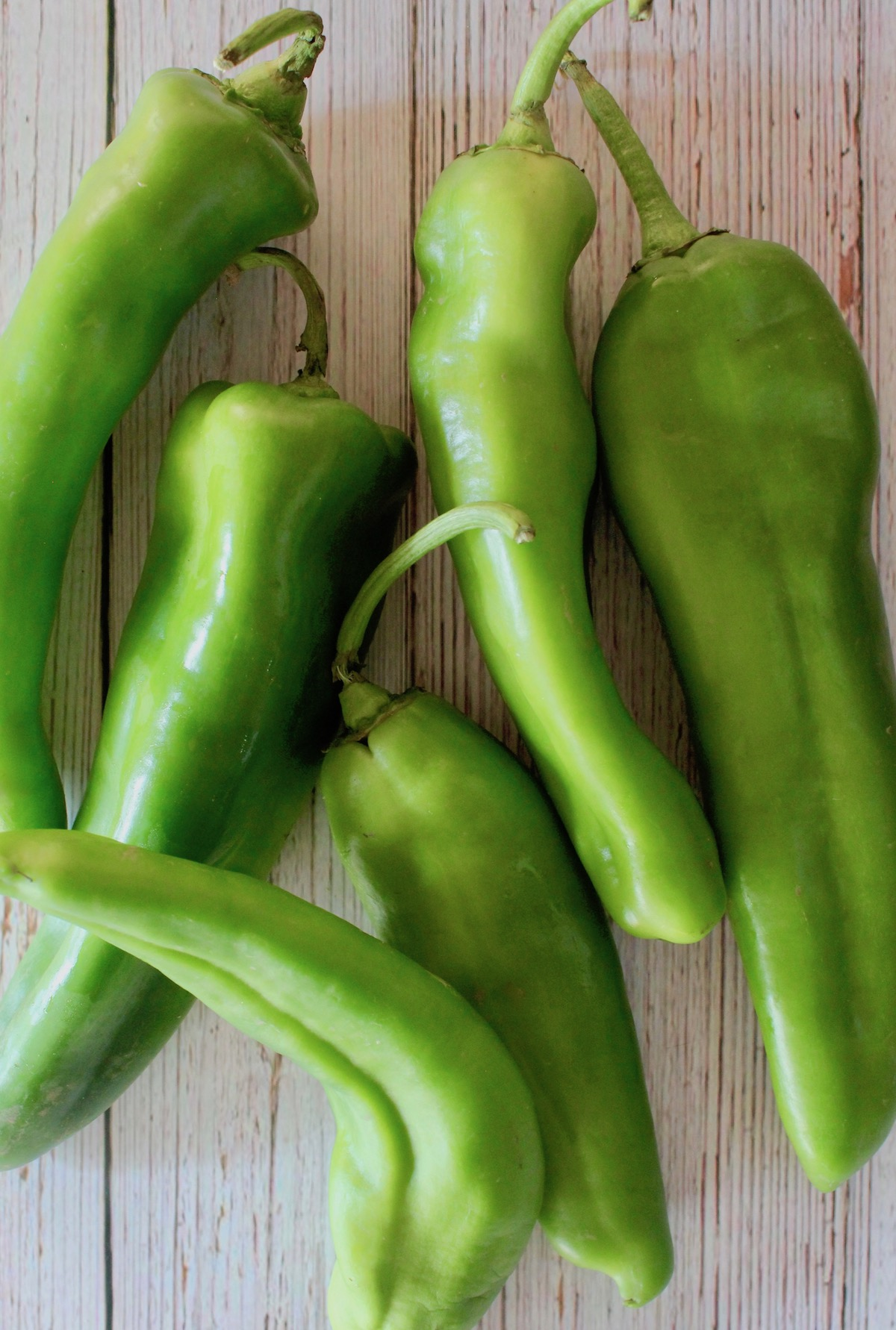 several bright green raw hatch chiles
