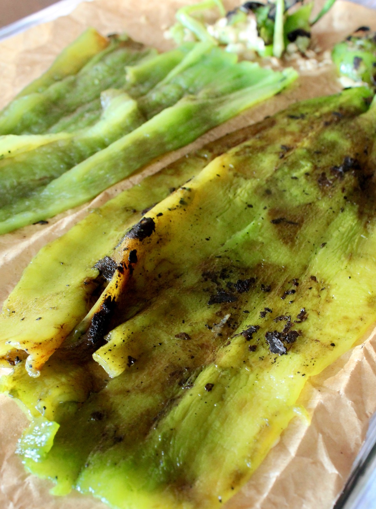 roasted, peeled and seeded hatch green chiles on parchment