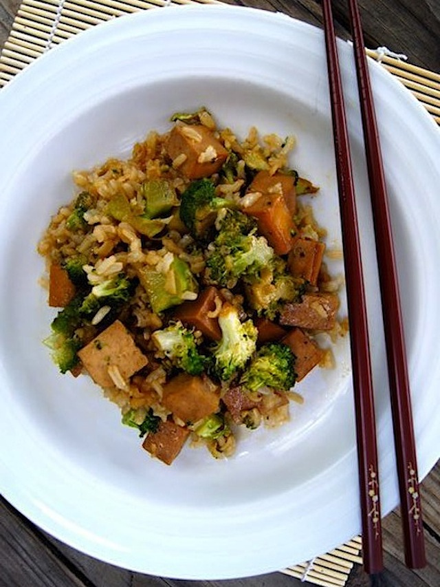 One Pan Meal, Honey Glazed Tofu and Broccoli on a bright white plate with burgandy chopsticks.