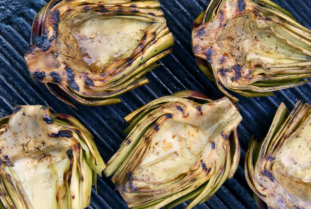 The Ultimate Stuffed Artichoke Recipe and pictured here are grilled artichokes, cut in half