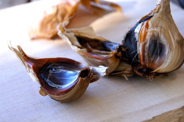 one clove of black garlic in the skin