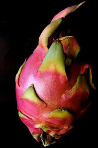 1 whole magenta Dragon Fruit with green markings.