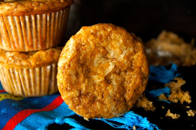 A few Mesquite Chipotle Cheddar Cheese Muffins withone on its side.