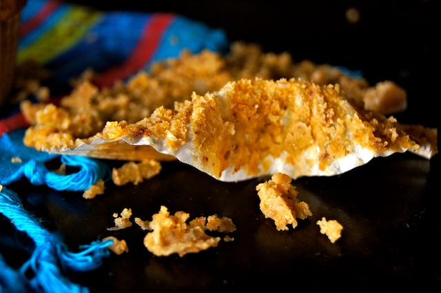 Paper muffin liner with crumbs from a Mesquite Chipotle CheddarCheese Muffin