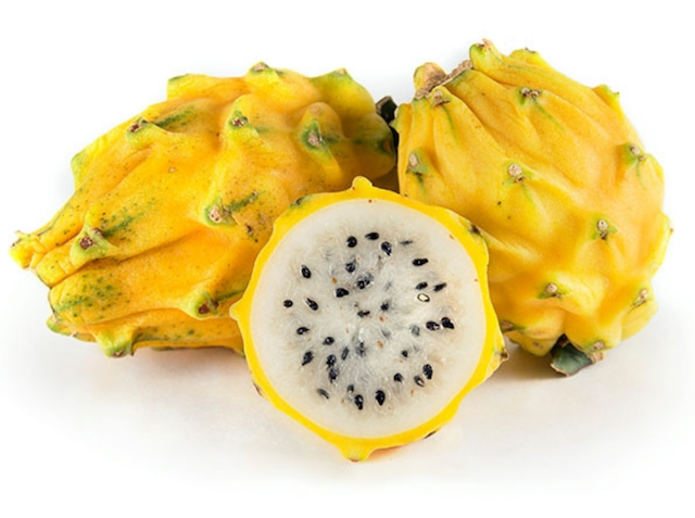 Yellow Dragon Fruit with white interior cut in half.