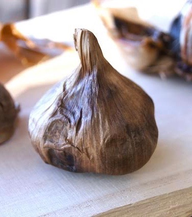 on head of black garlic for Black Garlic Pappardelle Pasta Reicpe