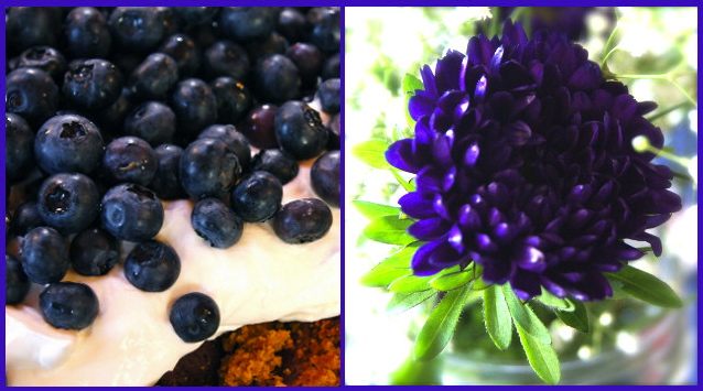 Pile of blueberries and a beautiful purple flower.