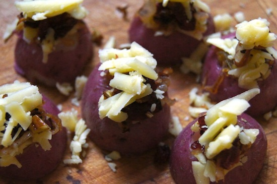 Cheddar Potato Bites with Cranberry Onions in the making on a cutting board