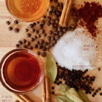 spices, honey and maple syrup on cutting board