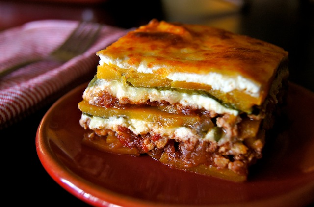 one slice of Spiced Chicken-Butternut Squash Lasagna on a red plate