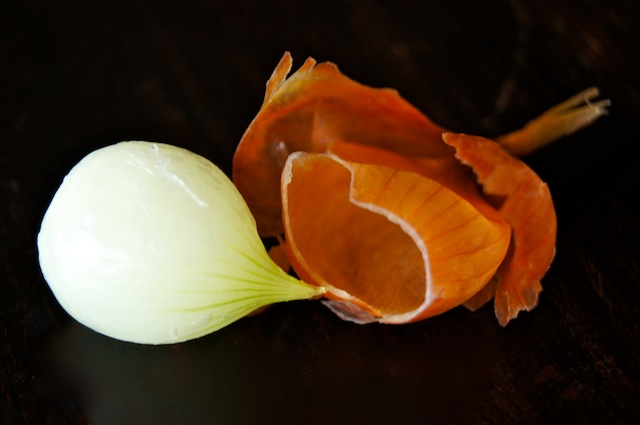 pearl onion with skin coming off