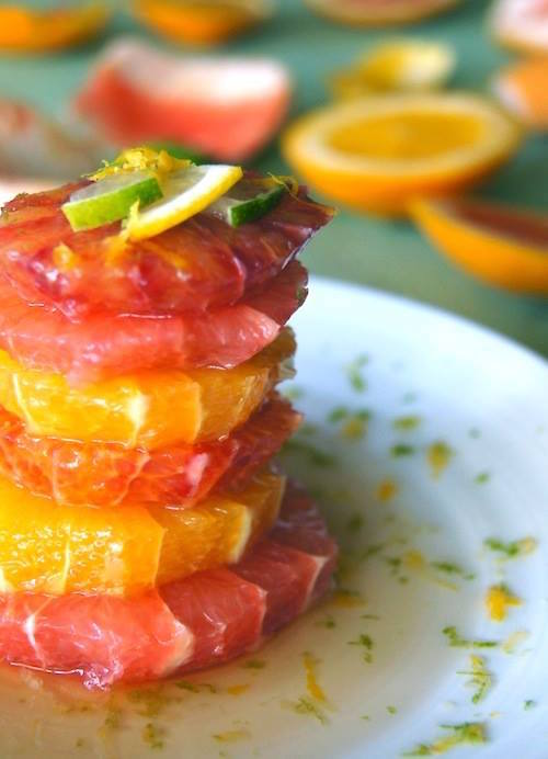 Spicy Honey Citrus Salad Stack on a white plate