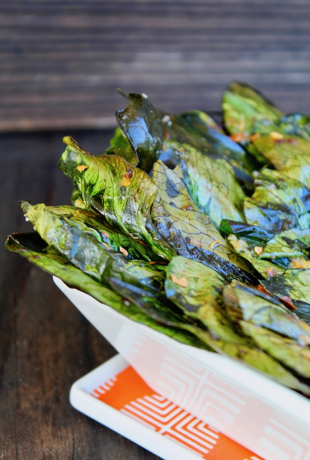 bok choy chips in square white dish with chili flakes