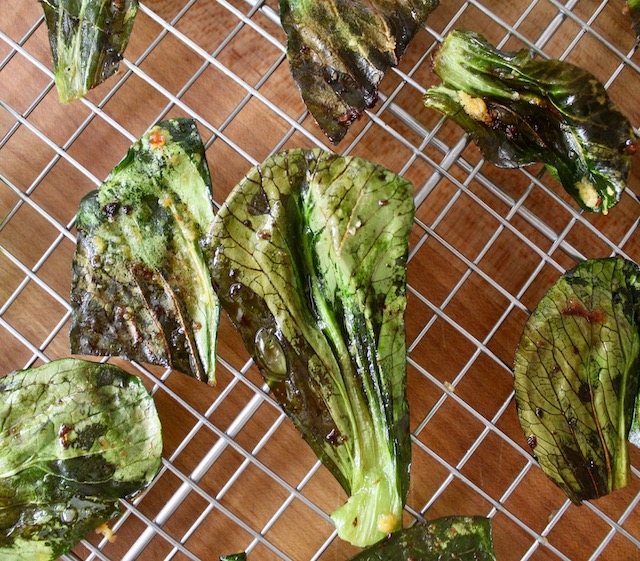 Bok choy chips on wire cooking rack
