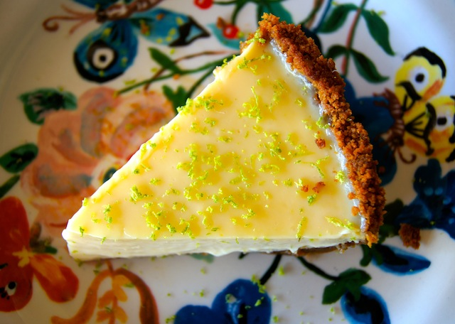 One slice of Ginger-Citrus Pie on a painted, floral, ceramic plate.