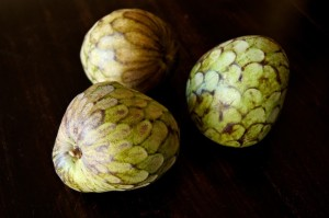 3 cherimoya fruit on black background