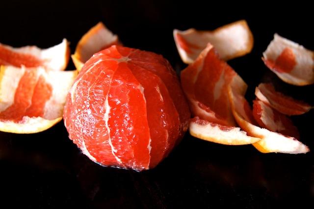 peeled grapefruit with skins around it