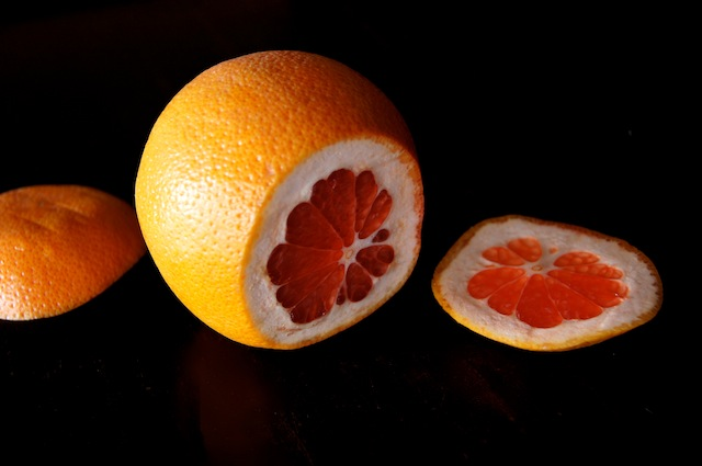 Grapefruit with top and bottoms sliced off