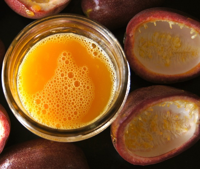 How to Cut, Eat, and Juice Passion Fruit - passion fruit skins and juice in a jar