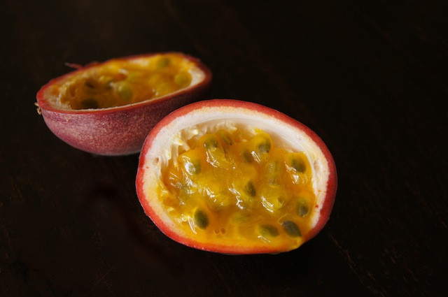 One passion fruit sliced in half