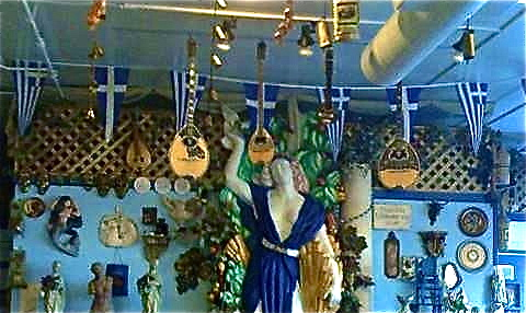 Interior of a Greek restaurant with guitars hanging from ceiling