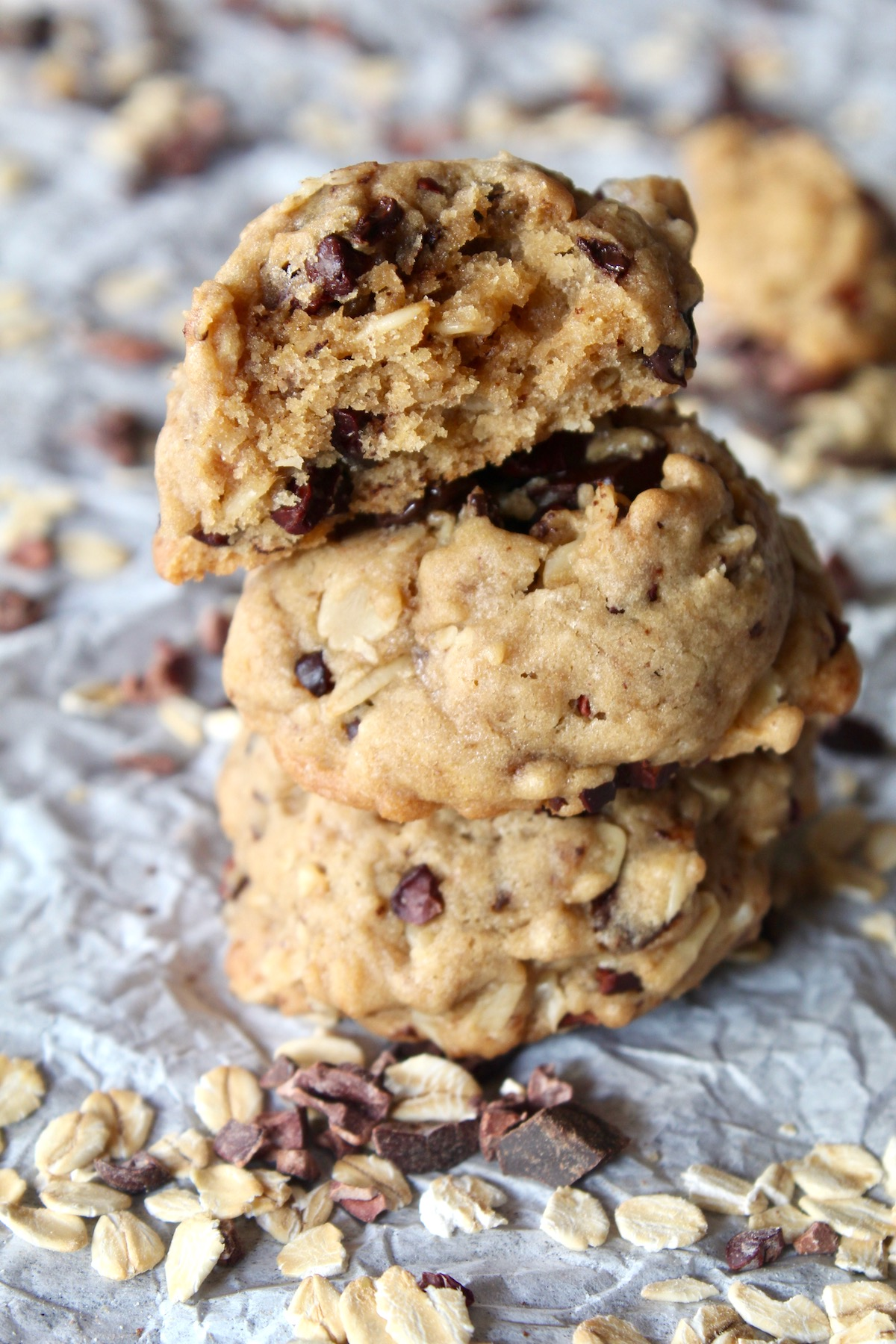 three cappuccino oatmeal cacao nib cookies with one broken