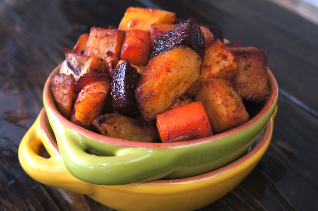 Smoky Cumin Roasted Root Vegetables in green bowl inside yellow bowl