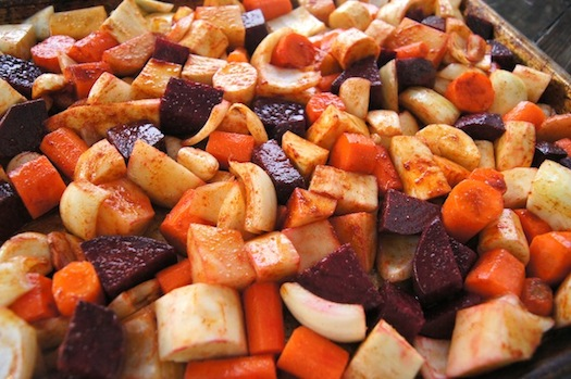 Raw Smoky Cumin Roasted Vegetables on a baking sheet
