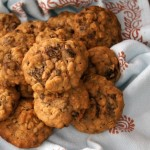 several oatmeal raisin cookies on a light blue cloth