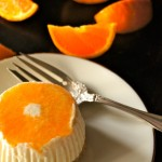 Citrus No-Bake Cheesecake in an individual portion, on a cream plate with an antique silver fork.