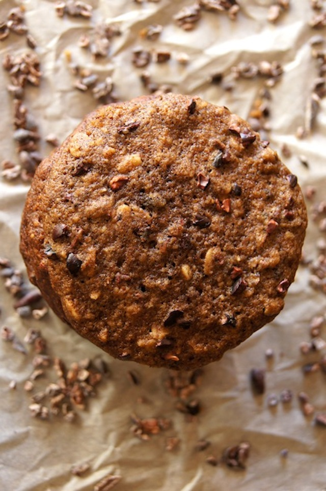 Chocolate, Oat and Espresso Breakfast Cookies, top view with cocoa nibs in the background
