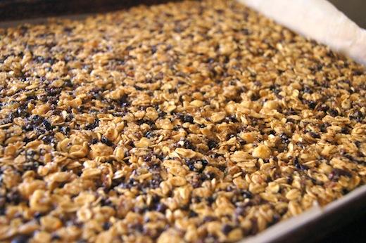 hazelnut granola bar mixture spread on sheet pan