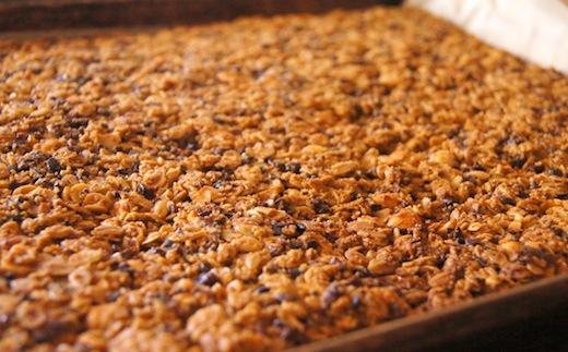 Baked Chocolate Orange Hazelnut Granola on baking sheet