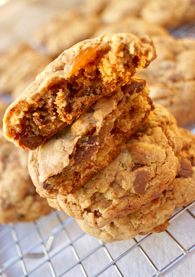 stack of 4 oatmeal raisin chocolate chip cookies with top cookin in piceces