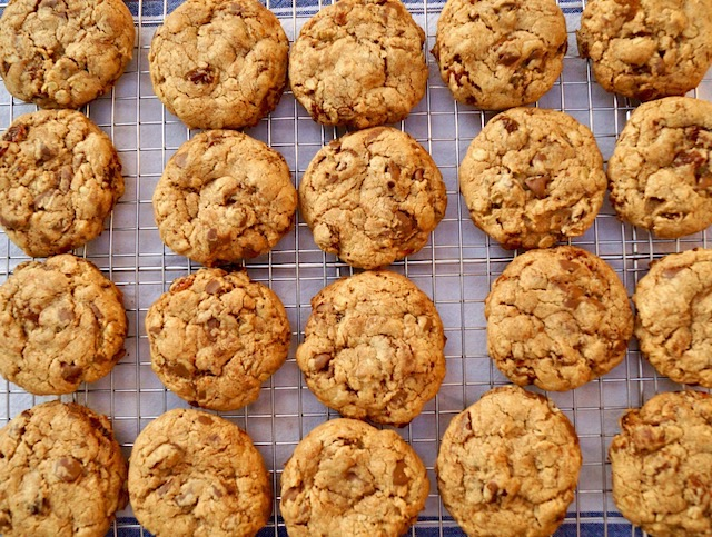 several oatmeal raisin chocolate chip cookies on a cooling rack