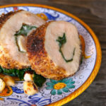 slices of hazelnut crusted chicken on italian painted plate
