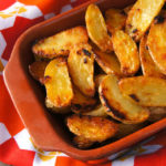 Cripsy Onion Fingerling Potatoes in a terra cotta dish