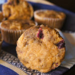 front of a blueberry blue corn muffin on its side
