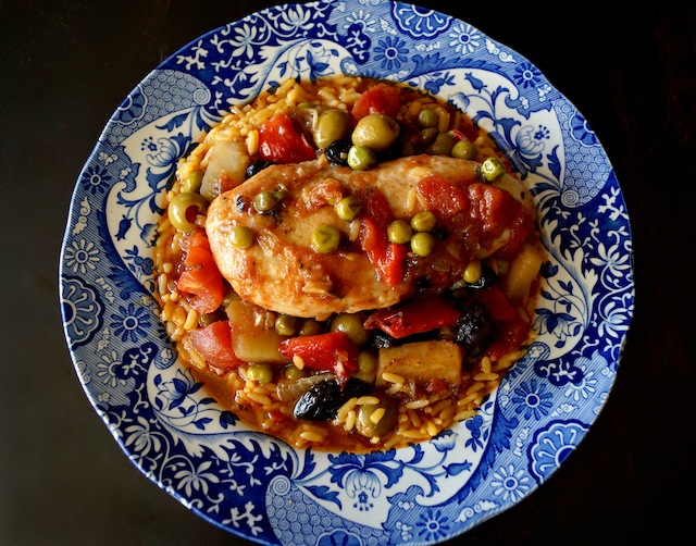 Cuban Chicken Stew with Alcaparrado in a pretty blue bowl