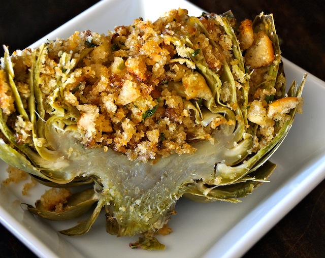 The Ultimate Stuffed Artichoke - beautiful green artichoke with golden breadcrumbs and herbs, cut in half