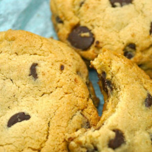 Close up of super chewy chocolate chip cookie with a bite