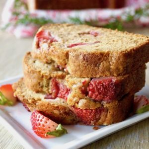 3 stacked slices of Rosemary-Strawberry Cake.
