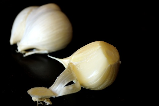 One clove of peeled Elephant Garlic.