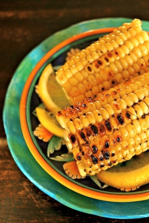 Lemon Pepper Grilled Corn on turquoise plate