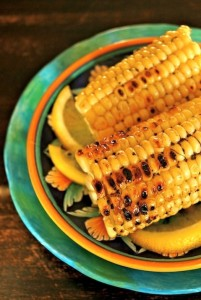 Lemon Pepper Corn on the Cob on turquoise plate