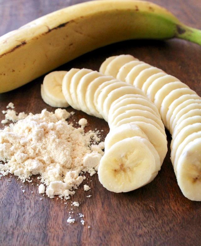 sliced banana and coconut flour on a dark cutting board