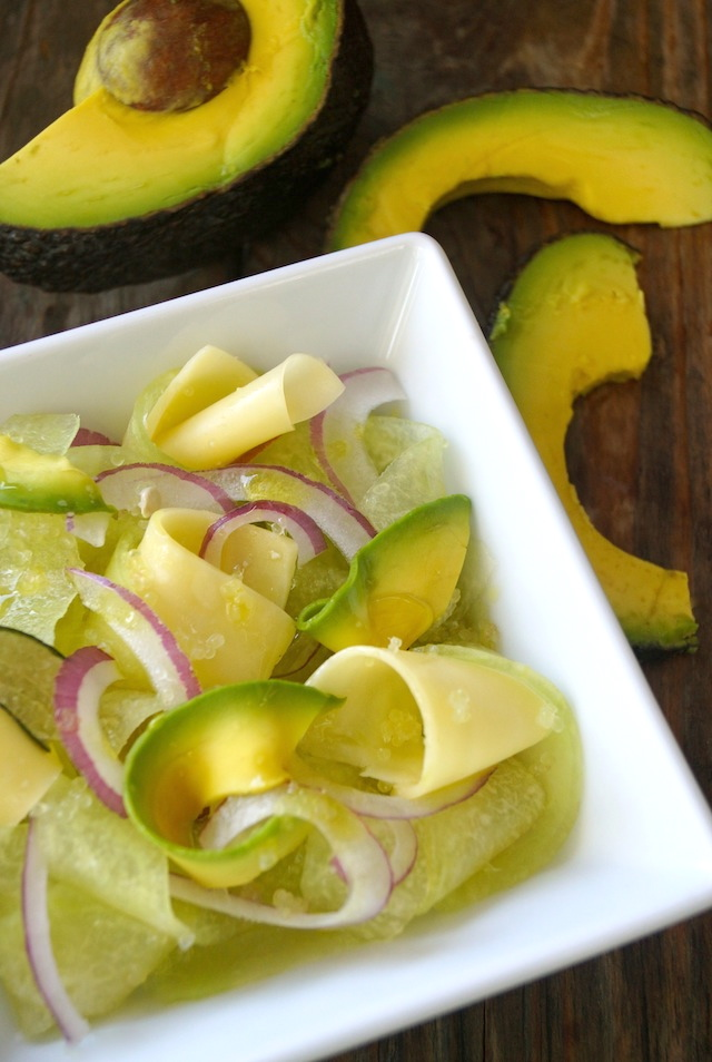 Shaved Melon-Avocado Salad in a white square owl with avocado slices around it