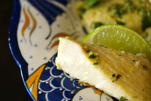Thai Mahi Mahi with slice of lime on blue and white ceramic plate