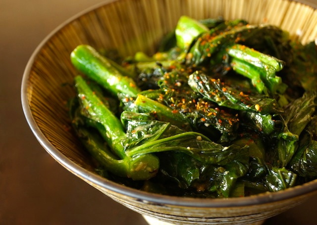 A bowl full of super the bright green Garlicky Coconut Gai Lan recipe.